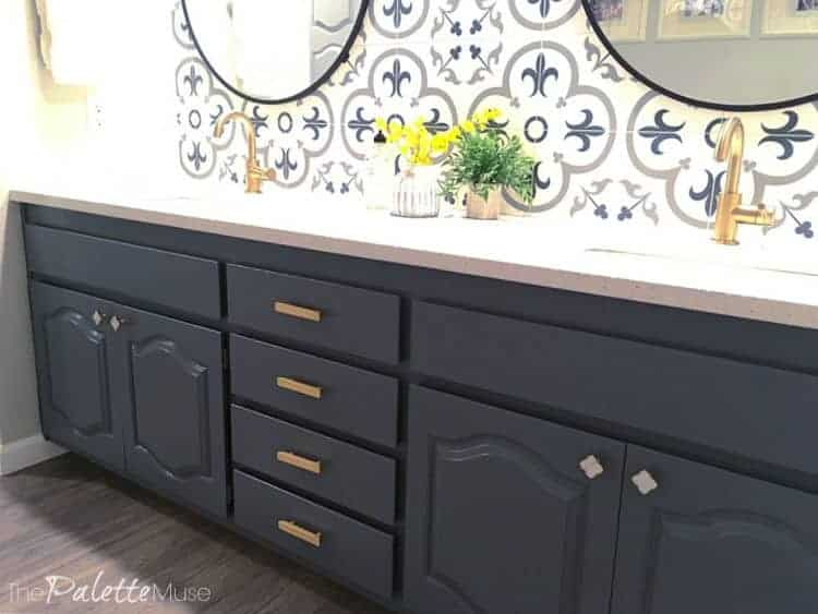 Dark gray painted cabinets in bathroom with patterned tile backsplash