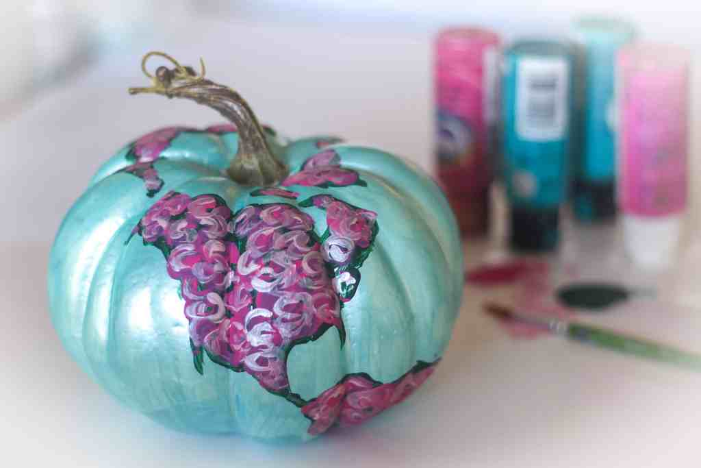 Floral painted pumpkin and painting supplies