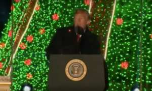 Christmas lights produce alarming red laser dots on President Trump's face during White House Speech