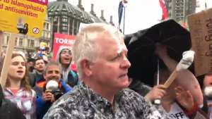 WATCH: Pro-Trump man milkshaked by radical left in Parliament Square