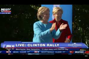 Hillary Clinton and Elizabeth Warren talking behind the scenes