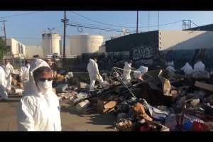 WATCH: Trump supporters pick up 50 tons of trash from L.A homeless camp