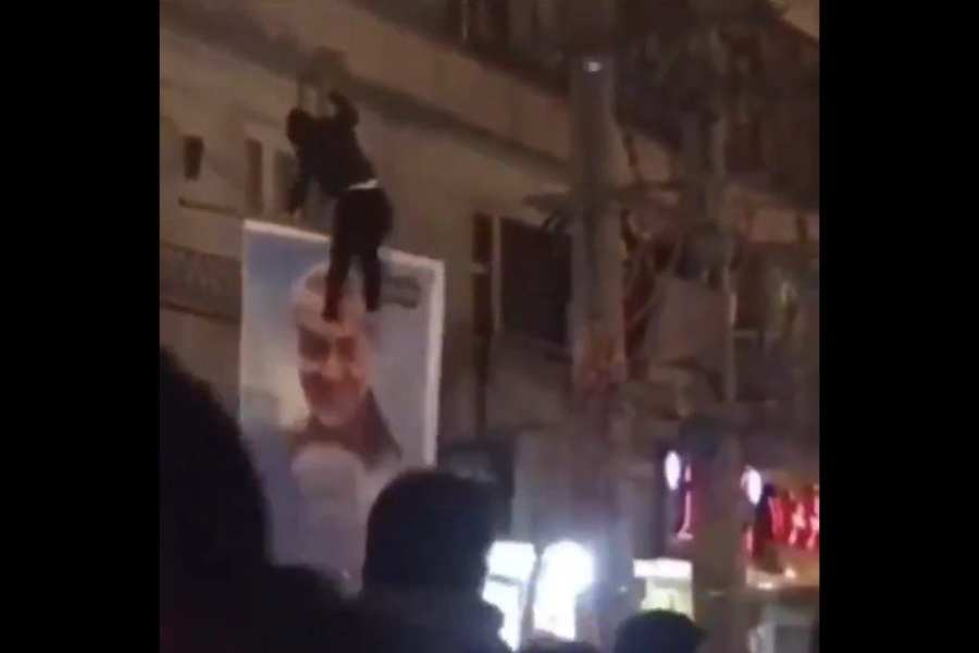 Video surfaces of Iranian protestor kicking Soleimani poster