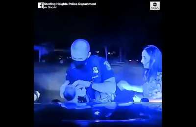 WATCH: Police Officer Saves Baby's Life