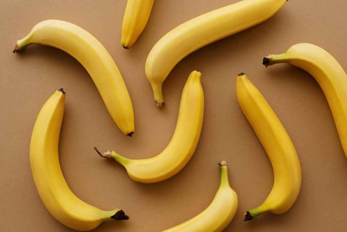 yellow banana fruits on brown surface
