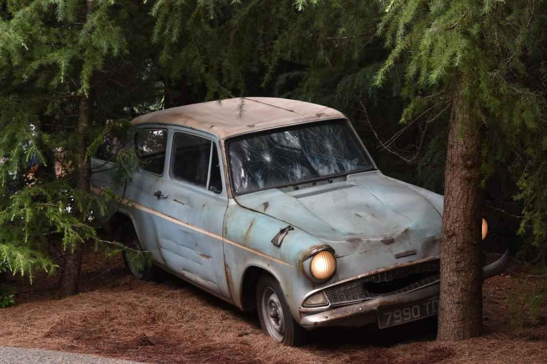 old car parked near tree