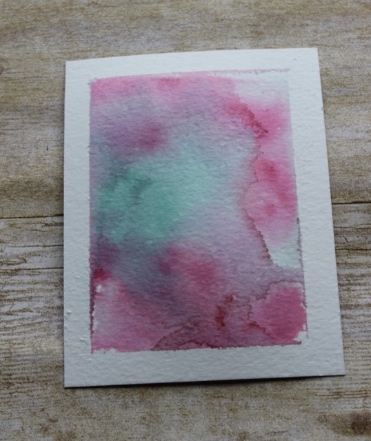 Watercolour wash background with an acrylic block E
