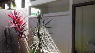 Outside the bathroom is a little private sitting area with more pretty plants and flowers.