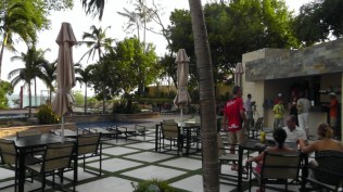 This is the terrace between the older building and the swimming pools. These appeared to be residents relaxing and visiting the snack bar there.