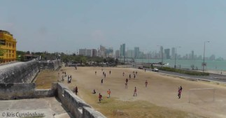 We climbed up to walk along the wall, and looked down on a field of people playing soccer.