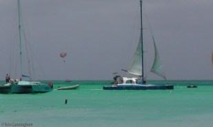 There were a lot of boats, and parasailing was going on in the distance.