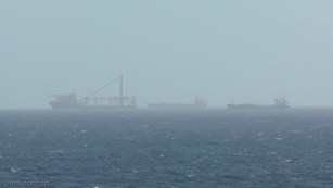 Some other ships become visible in the distance.