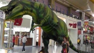 Holly looks small under the t-Rex. There is a Super 99 doorway there which gives no clue how big that store really is. It's like a super Walmart with groceries and pretty much anything else you can think of.