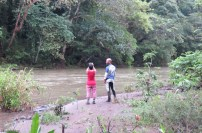 Elif and Alain take photos. After the downpours the river was active and muddy.