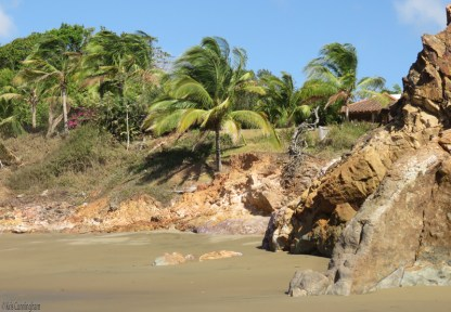 Some large rocky areas along the beach