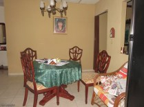 The dining room. There is also a small sitting room to the right in front of the dining room.
