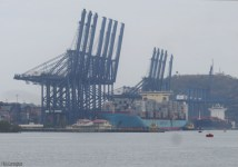There was a big container ship on the far side loaded with containers.