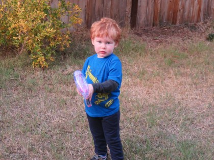 This bubble gun is pretty cool and he knows how to work it.