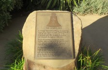This plaque tells about the Italian bell above the entrance.