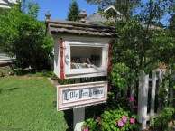 Is this the coolest thing ever?! A little library in the neighborhood