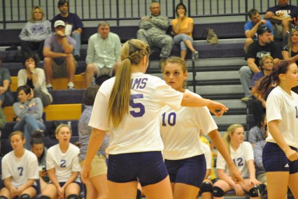 Junior Claire Cornwell and Freshman Keaton Chastain talk over the last play. The girls lost after three close sets to the Christian Academy. ¨Claire is always trying to get the best out of me,¨ said freshman Keaton Chastain.
