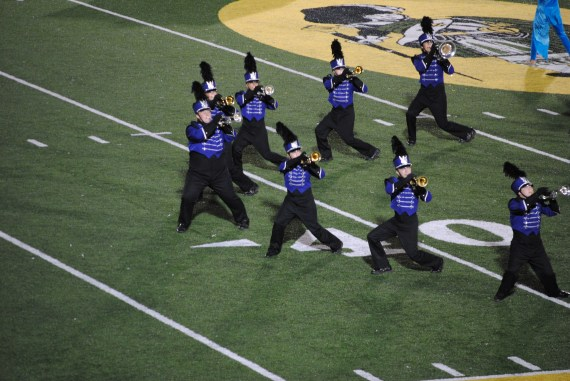 The trumpets do a dance during a trade off.