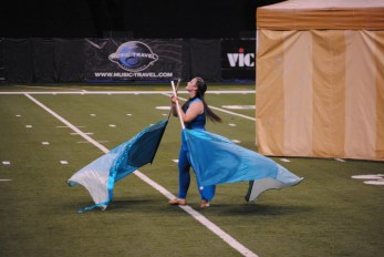 The color guard get their blue flags flying at BOA.