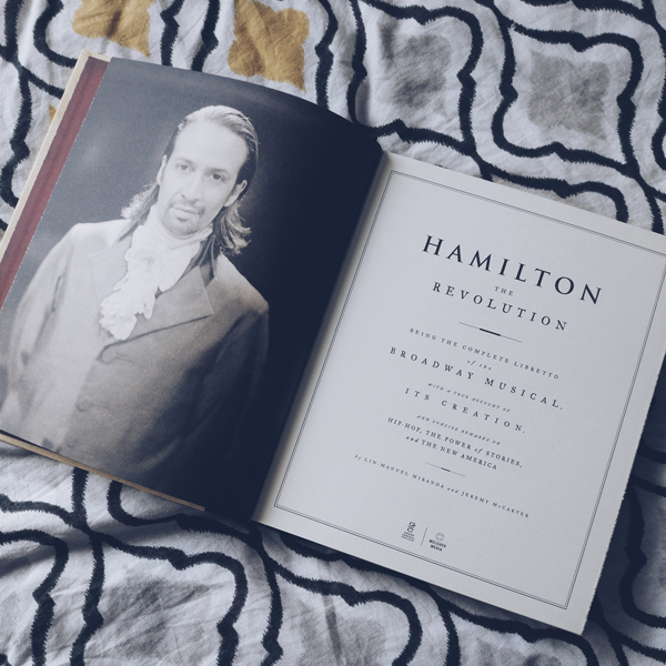 Photo of Lin Manuel Miranda and first page of Hamilton: The Revolution.