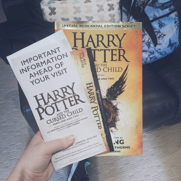 image shows a copy of Harry Potter and the Cursed Child script book along with tickets for Harry Potter and the Cursed Child