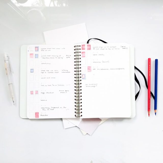 example of page in notebook with red and blue pencil