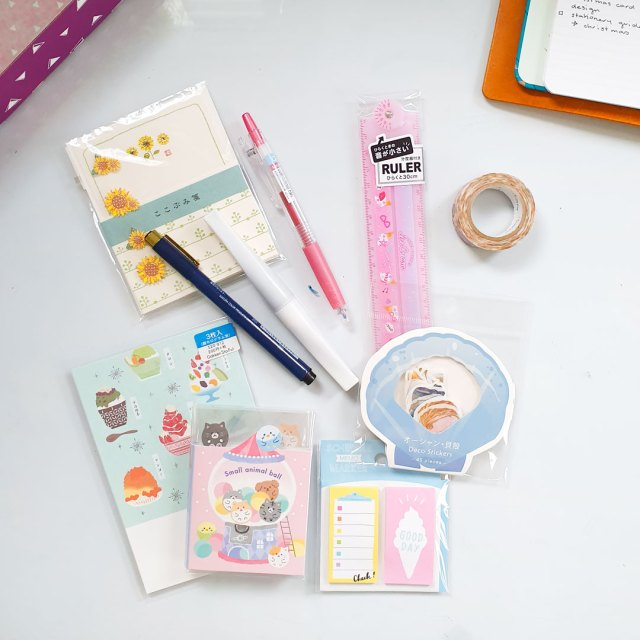 Contents of Zenpop stationery box including pens, sticky notes, and washi tape.