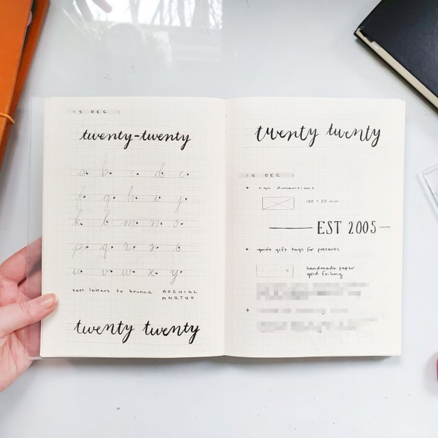 Image shows bullet journal page with practise lettering.