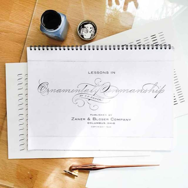 Image shows Ornamental Penmanship, an old calligraphy book which has been printed and bound.