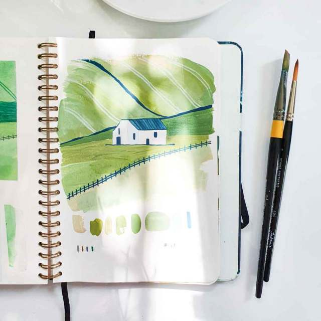 Sketchbook page showing a painting of a house. Painting can be a rewarding creative hobby.