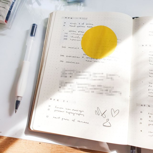 Image shows my daily planning routine in a bullet journal and an essay plan.