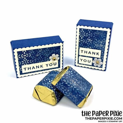 This is a handmade treat box featuring the Stampin' Up! Rectangular Postage Stamp Punch and Boho Indigo Product Medley. The treat box features a flower embellishment with the sentiment Thank you.