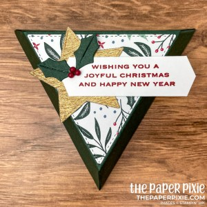 This is a tapered triangle gift box made with the Tidings of Christmas Stampin' Up! suite and the sentiment says Wishing You a Joyful Christmas and Happy New Year