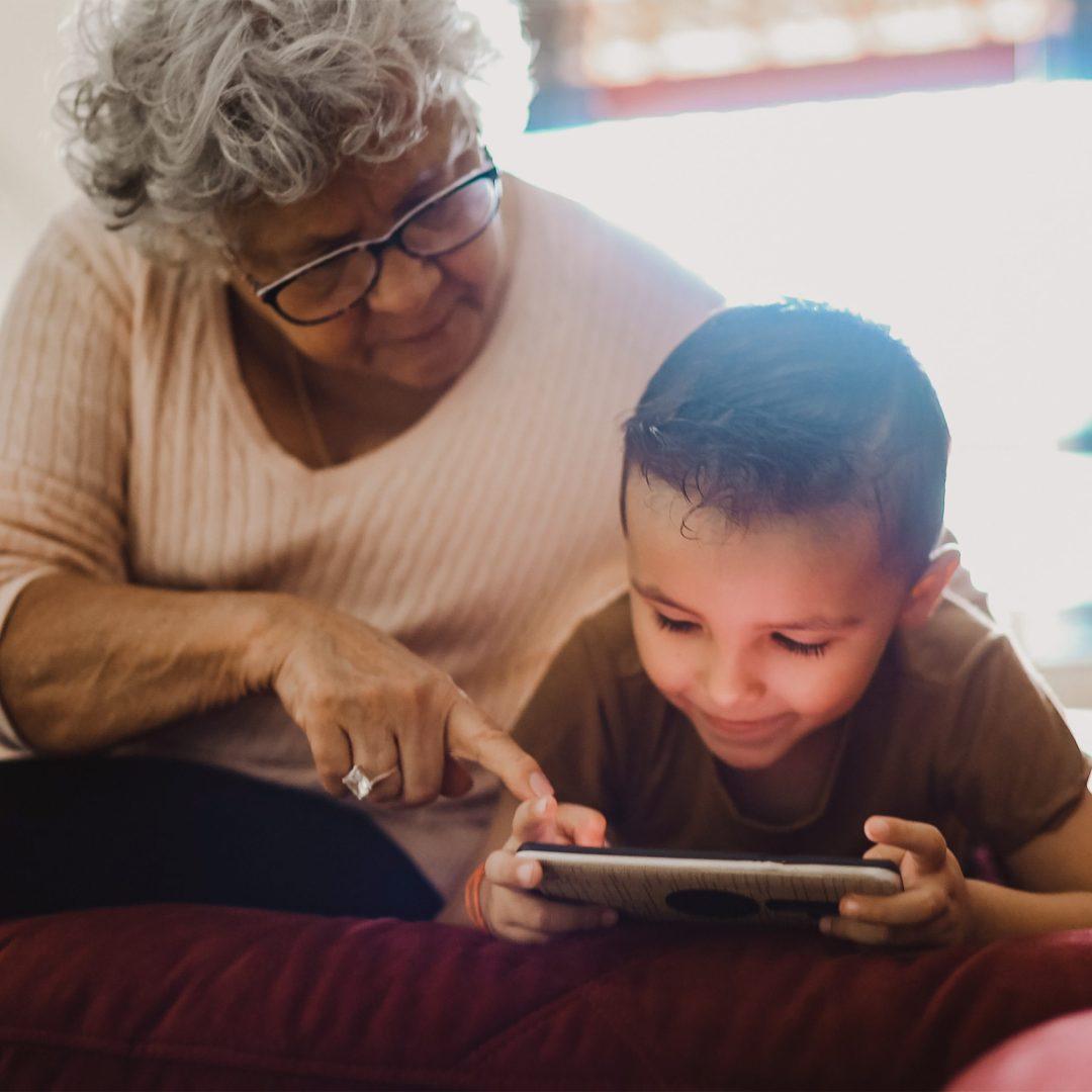 Grandparent and Child with Parent Cue App