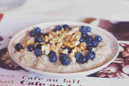 blueberries and nuts on porridge