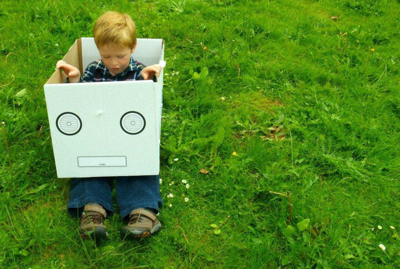 Boy sitting in a box in the garden