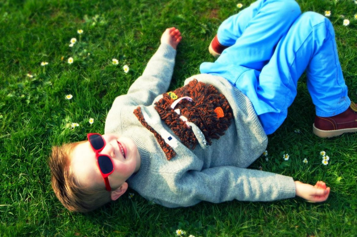 Little boy lying in flowers