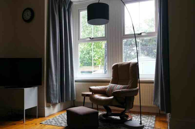Decorating living room, beige 60s chair with black lamp