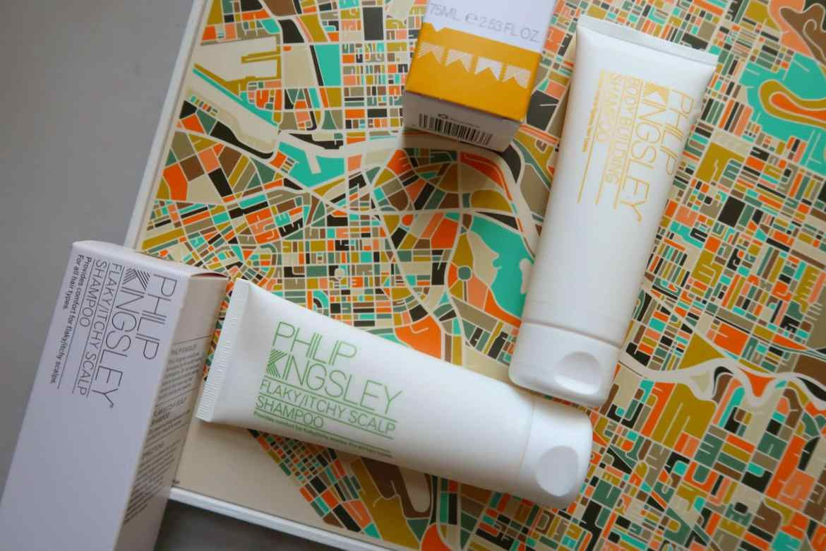 Phillip Kingsley shampoo bottles on colourful map
