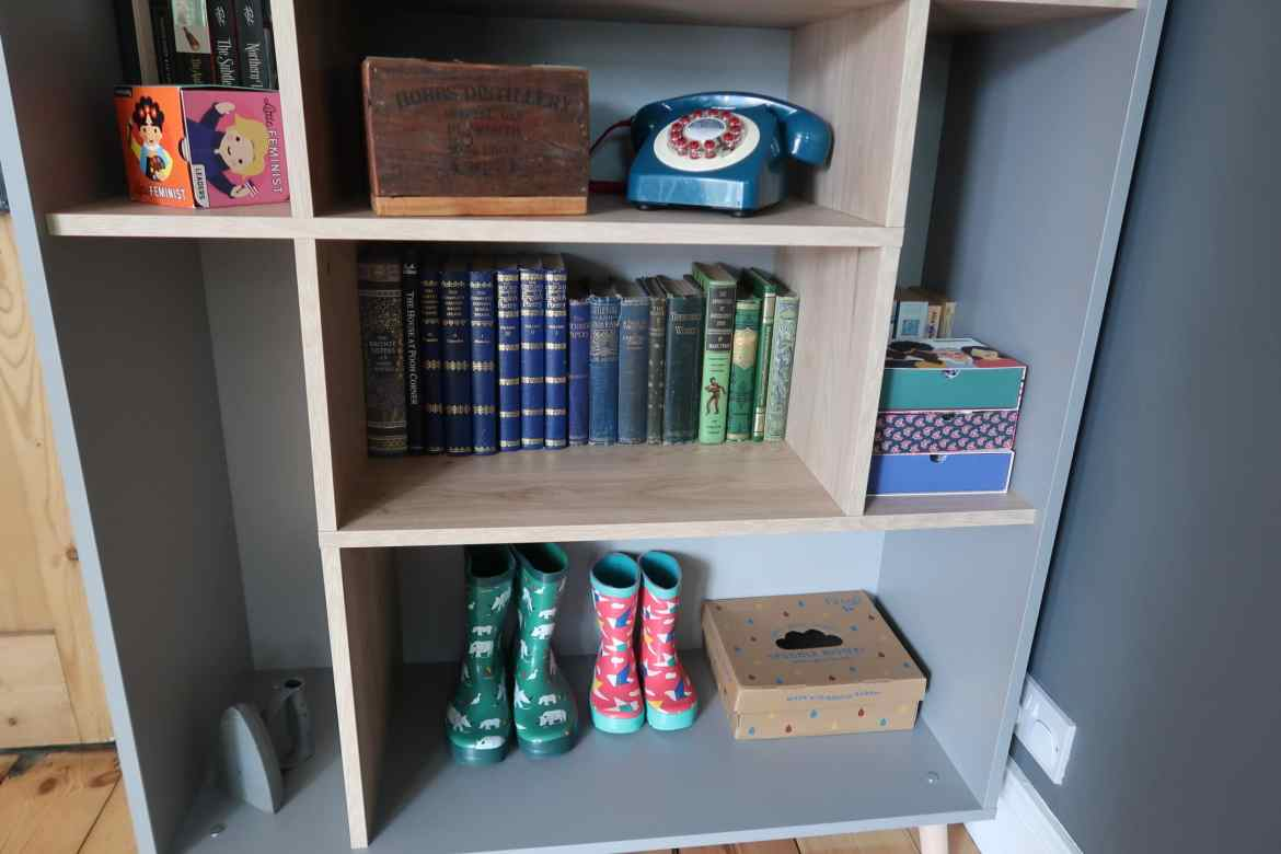 Frugi wellies on a colourful bookshelf