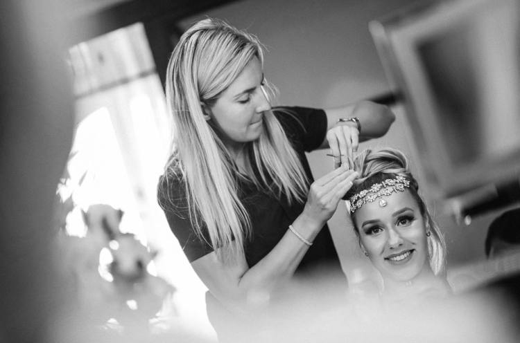 Bride having professional hairstyling and getting ready for her elopement in Paris at the Peninsula Paris