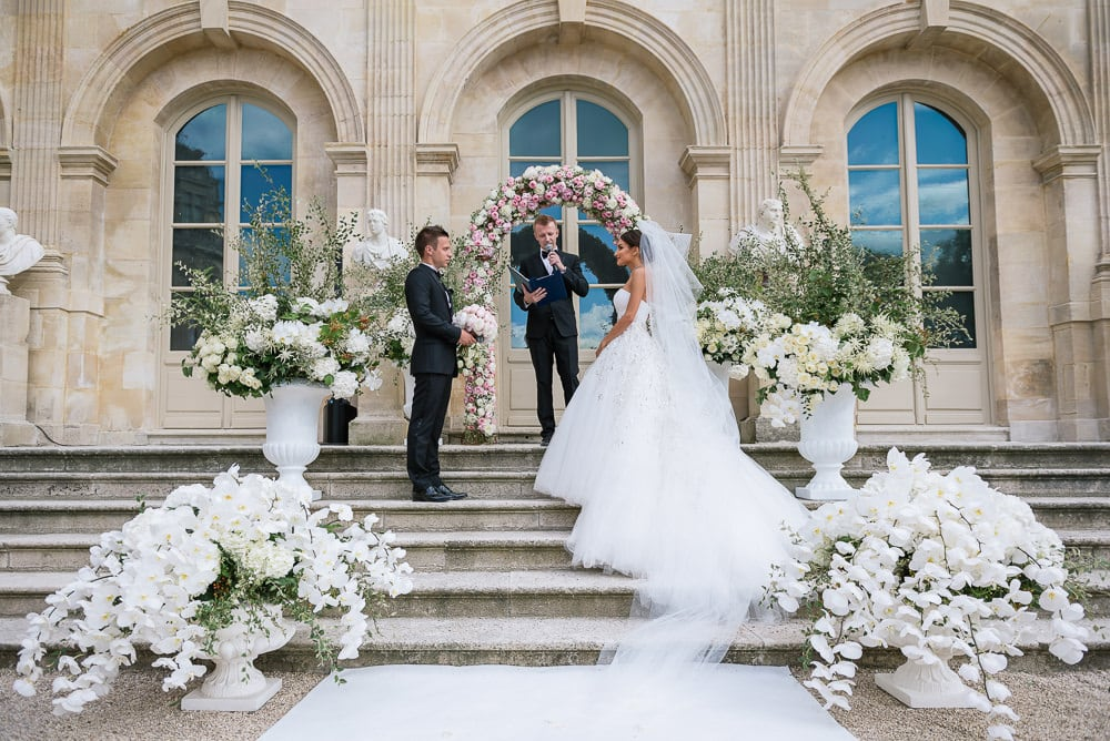 Elope in Paris - Bride in Dior couture wedding dress having elopement ceremony in Paris - Planned by CTH Events Paris