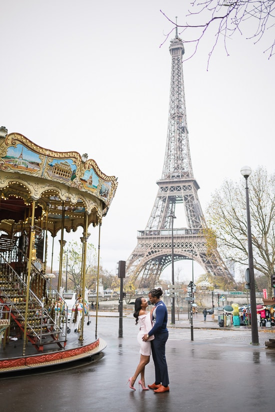 Kissing in the street near the Carousel of the Eiffel Tower