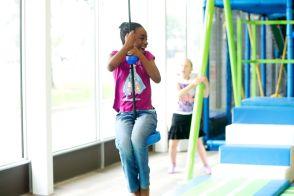 a girl swings on the zipline