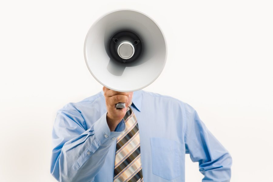 Man with megaphone, illustrating productivity pushers