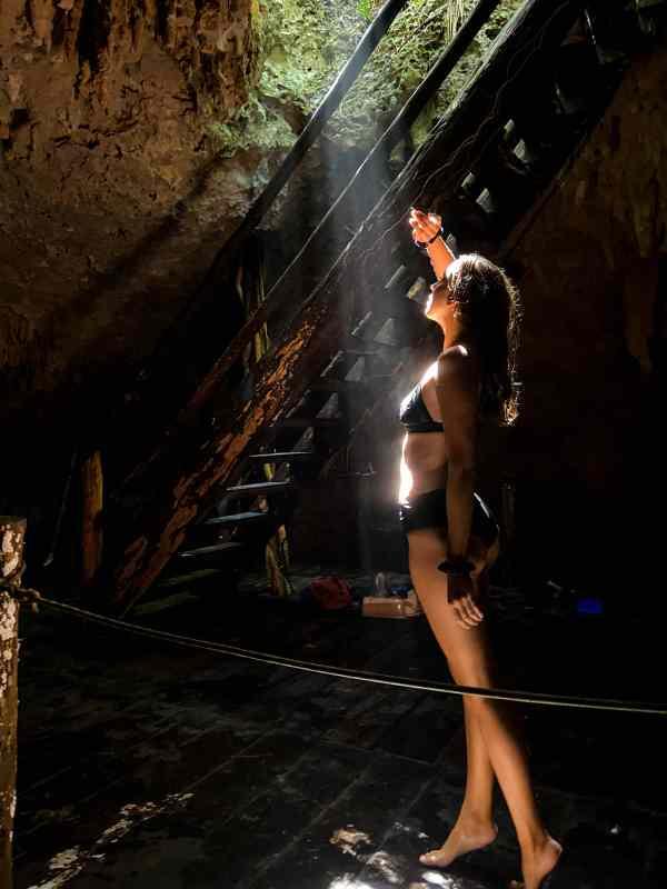 Alicia Under Cenote Light on Adventure Tour